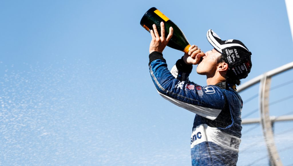 Takuma Sato drinks the champagne in Victory Circle after winning the Grand Prix of Portland at Portland International Raceway -- Photo by: Joe Skibinski